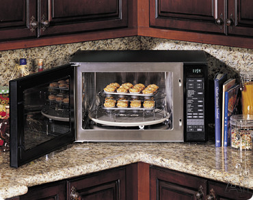 ... Microwave with 900 Watts of Power Stainless Steel Interior and 10